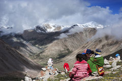 A whole Tibetan family circumambulating Mt. Kailash Stock Images