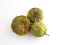 Whole tomatillos on a white cutting board Royalty Free Stock Photos