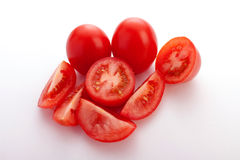 Whole tomatoes and slices of tomatoes Stock Image