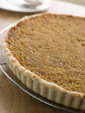 Whole Treacle Tart on a Cooling Rack Stock Photo