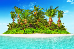 Whole tropical island within atoll in tropical Ocean. Stock Photos
