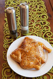 Whole uncooked marinated chicken on plate Stock Photography