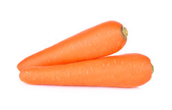 Whole unpeeled fresh carrot on white background Stock Photos