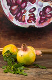 Whole unripe pomegranates with a blurred painting background on Stock Images