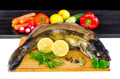 Whole walleye fish with vegetables Stock Image