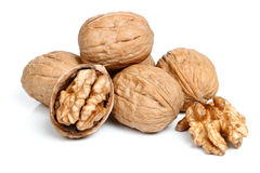 Whole walnut and half walnut piece. Royalty Free Stock Photo