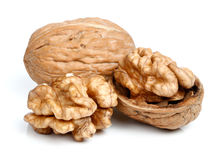 Whole walnut and half walnut piece. Stock Image