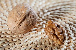 Whole walnut and walnut's kernel Royalty Free Stock Photo