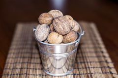 Whole walnuts in a decorative metal pail Stock Images