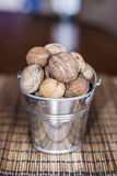 Whole walnuts in a decorative metal pail Royalty Free Stock Photo