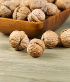 Whole Walnuts inside Shell on Faded Wood Stock Photos