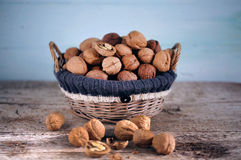 Whole walnuts piled in a basket Stock Images