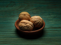 Whole walnuts on rustic old wooden table Royalty Free Stock Photos