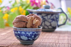 Whole walnuts with shell in a bowl Stock Photography