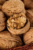 Whole walnuts in a wicker basket Royalty Free Stock Photo