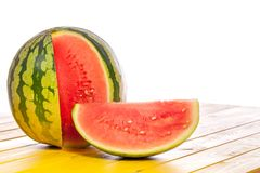 Whole watermelon with cut slice. Summer refreshment image with c. Opy-space. Nutritional mouth-watering and thirst-quenching fruit against white background Royalty Free Stock Photo