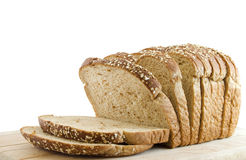 Whole Wheat. Sliced loaf of whole wheat bread isolated on white Royalty Free Stock Photo