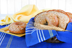 Whole wheat bagel and bread in a basket. Stock Photo