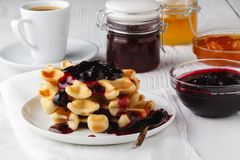 Whole wheat Belgium waffle topped with boysenberry syrup stock image