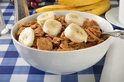 Whole wheat and bran cereal. A bowl of whole grain wheat cereal with bran and sliced banana Royalty Free Stock Photography