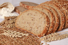 Whole wheat bread. Cut on slices royalty free stock photos