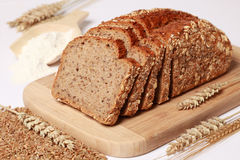 Whole wheat bread. Cut on slices stock photos