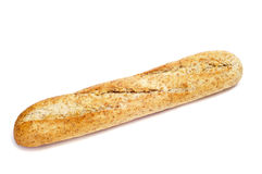 Whole wheat bread. A demi baguette of whole wheat bread on a white background Stock Image