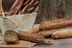 Whole wheat bread. Baguettes dark bread. Sliced whole grain brea Stock Photo