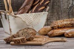 Whole wheat bread. Baguettes dark bread. Sliced whole grain brea Stock Images