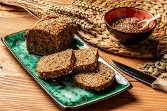 Whole wheat bread baked, bio ingredients, healthy with seeds. top view stock image