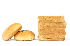 Whole wheat bread and filled bun Royalty Free Stock Image