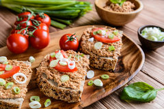 Whole wheat bread with fish spread, tomato and onion Stock Photography