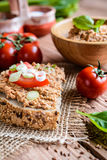 Whole wheat bread with fish spread, tomato and onion Stock Photos