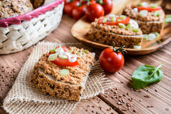 Whole wheat bread with fish spread, tomato and onion Royalty Free Stock Images