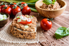 Whole wheat bread with fish spread, tomato and onion Royalty Free Stock Photography