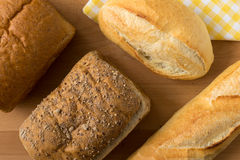 Whole wheat bread and French baguette Royalty Free Stock Photos