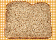 Whole Wheat Bread. Fresh and nutritious whole wheat bread on abstract gingham background Stock Photo