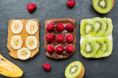 Whole wheat bread with fruits and berries for breakfast Royalty Free Stock Image