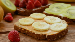 Whole wheat bread with fruits and berries for breakfast stock footage