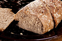 Whole wheat bread. Homemade Whole wheat bread on Black plate royalty free stock image