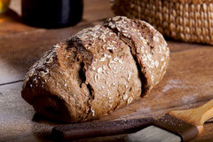Whole wheat bread. Homemade Whole wheat bread on a wooden table Royalty Free Stock Photo