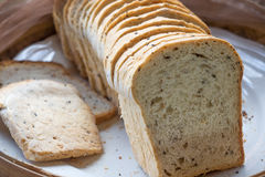 Whole wheat bread. A loaf of whole wheat bread sliced for healthy breakfast Royalty Free Stock Photo
