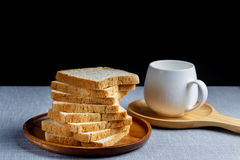 Whole Wheat Bread. And milk on gray cloth Royalty Free Stock Photography