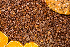 Whole wheat bread and  pieces orange on roasted coffee Royalty Free Stock Photo