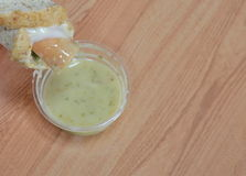 Whole wheat bread roll sausage dipping sour sauce Stock Photo