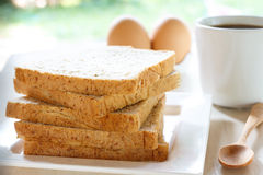 Whole wheat bread slice. Breakfast: whole wheat bread slice with coffee Royalty Free Stock Photography