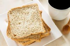 Whole wheat bread slice. Breakfast: whole wheat bread slice with coffee Stock Photo