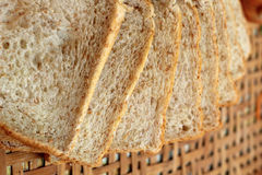 Whole wheat bread sliced ​​on a basket Stock Photography