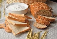 Whole wheat bread sliced with wheat flour. Whole wheat bread sliced with wheat flour on the sack Stock Photo