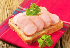 Whole wheat bread with sliced sausage Royalty Free Stock Photo